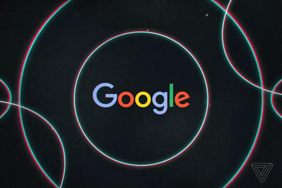 Kruhy na černém pozadí s Google logem uprostřed
